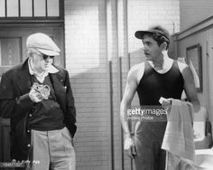 John Ford talking to Tyrone Power in between scenes from the film 'The Long Gray Line', 1955. January 01, 1955.