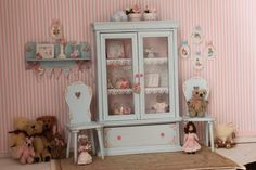 Cute shabby cabinet for dollhouses, scale 1 12. Handpainted and distressed. Decorate with lovely paper. The drawer can be open. Measures 10 cmlong x 3,5cm deepx 15 cm high Accesories inside the cabinet are not included in the price but if you are interested in any accessories in the picture just contact me. If you have any questions or if you would like a special order,just contact me. Not suitable for children.