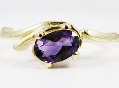 Amethyst Oval offset Gold Ring