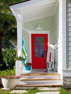 Porch.  Note shower and faucet...should be standard on all back porches! Better Homes & Garden bhg.com