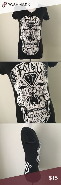 """RARE GOTH PUNK GRUNGE SUGAR SKULL TEE SHIRT TOP !! Vintage Early 00's 2000's 2000 Y2K Goth Gothic Punk Emo Scene Grunge Alternative Witchy White Day of the Dead Sugar Skull Distressed Crackled Graphic on Slightly Faded Black SOFT Tight Fitted V Neck Tee Shirt Top  Brand new. Never used. NO flaws  Tagged as a Small, but best Women's XS best!  •Chest- 14.5"""" across •Length (shoulder to bottom hem)- 24.5"""" long  Seen modeled on: •Women's size XS •33"""" chest (A cup/B cup) •24"""" waist •32""""-33"""" hips…"""