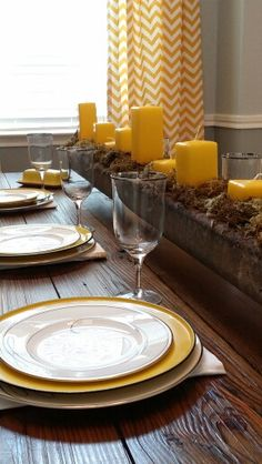 Yellow and grey. Candlestick Lamps, Candlesticks, Dining Room Centerpiece, Centerpieces, Chevron Curtains, Yellow Candles, Oak Dresser, Antique Buffet, Engineer Prints