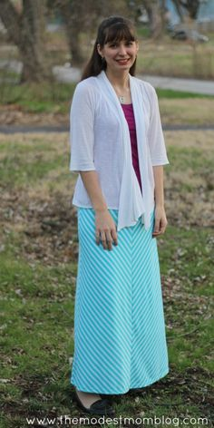 Modest Monday and a Link Up! I'm wearing a teal striped maxi skirt with colors of springtime! | themodestmomblog.com