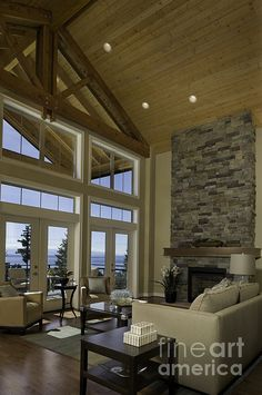 Other than the wood ceiling and top of the window, I absolutely LOVE the windows and cathedral ceiling for a family room. so open!
