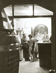 Doisneau - feeling of peeking in on something; shooting from dark into light