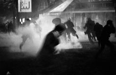 """Boulevard St. Michel, Paris, May 10-11, 1968. Explosion of tear gas. Photograph by Bruno Barbey. Click-through for more photos from Magnum's new book """"Magnum Revolution: 65 Years of Fighting for Freedom""""."""