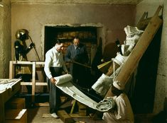 "Nov. 29, 1923 Howard Carter, Arthur Callender and an Egyptian worker wrap one of the sentinel statues for transport. IMAGE: HARRY BURTON (C) THE GRIFFITH INSTITUTE, OXFORD. COLORIZED BY DYNAMICHROME FOR THE EXHIBITION ""THE DISCOVERY OF KING TUT"" IN NEW YORK."