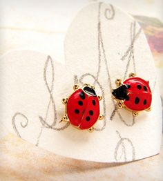 """These """"new"""" old stock of ladybug posts are hand-painted and enameled in bight red and black polka dots with surgical steel posts. Just 9mm long, they add a splash of color and good luck. (The ladybug is considered a harbinger of good luck and prosperity.)"""