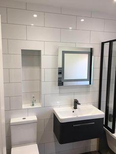 Increased Storage Space In This Latest Bathroom Transformation - Blok Designs Ltd Fitted Bathrooms, Luxury Bathrooms, White Wall Tiles, White Walls, Long Bath, Topps Tiles, Vinyl Flooring, Corner Bathtub, Storage Spaces