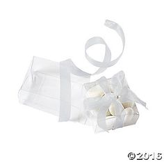 These clear plastic boxes make easy work of assembling party favors! Perfect for mints, nuts or candy, these present-shaped containers will add an elegant ...