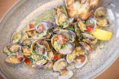 CLAM SHACK manila clams, prawns, cod, linguiça sausage, red potatoes + garlic butter