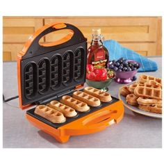 Create golden brown waffle sticks using the Babycakes waffle maker. Use your favorite waffle mix, serve with fruit and powdered sugar, coat in chocolate Waffle Cake, Waffle Mix, Waffle Iron, Delicious Cake Recipes, Yummy Cakes, Cool Kitchen Gadgets, Cool Kitchens, Top Gadgets, Waffle Sticks