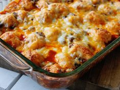 """This super-simple enchilada bake is one of our most popular casseroles, and it's easy to see why! With only six ingredients and 15 minutes of prep, it's as simple as can be. Refrigerated biscuits add a hearty texture and the distinct """"bubbles"""" that pop up when it bakes. The sauce is very mild in this dish; if you like, spice it up by adding in some chopped jalapenos, or using pepper jack cheese instead of a Mexican cheese blend."""