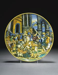 "A FAENZA MAIOLICA DISH, WORKSHOP OF VIRGILIOTTO CALAMELLI, ABOUT 1550-60 painted with the sacrifice of Marcus Curtius, inscribed on the reverse ""Hurcio romano"" within yellow concentric lines 28cm diameter"