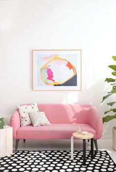 This black and white rug actually works with a pink couch