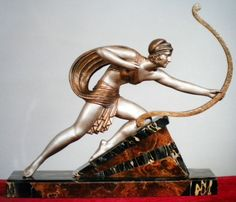 DIANA    Diana the Huntress. Sculpture in Silver and Gold Metal ( Spelter ). Base Portoro Marble and Onyx. Signature on the base.    Made in FranciaCirca 1930  Demetre H.Chiparus OMG SO BEAUTIFUL