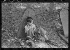 Son of one of the deceased's family at an annual memorial meeting in the family cemetery. In the mountains near Jackson, Kentucky. 1940 Aug. Library of Congress.