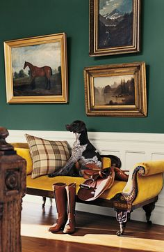 From Ralph Lauren Paint, gilded frames against a front entry painted in Windsor green, with trim Polo Mallet White. A German Shorthaired Pointer makes himself at home on a classic settee.