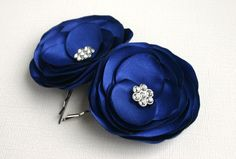 Think I like these. I believe they can be custom made with pearls instead of rhinestones.   Blue Flower Hair Clips For Wedding  Navy Blue by SarasBoutique, $14.00