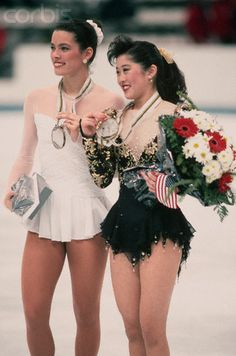 Nancy Kerrigan (Bronze) & Kristi Yamaguchi (Gold) show off their Olympic Medals at the 1992 Olympics in Albertville.