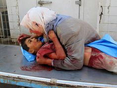 Image similar to the one that Sarah took in Iraq.  A woman holding their child while the child is dying.