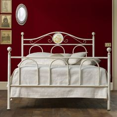 Whitey Bed by Cosatto This bed speaks of old tales told by the fireplace and grandmother's homes. Cosatto takes a traditiona, typically Italian style and brings it to modernity and contemporaneity. The wrought iron frame tells the story of furniture in Italy and is very durable, reliable and resistant.