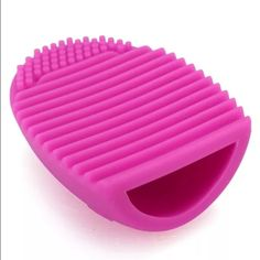 Hot pink Brushegg makeup brush cleaner new Selling a hot pink  brush egg. Used to clean your dirty makeup brushes! Just add soap to the egg and move the brush up and down! 3x3x1 inches 100% silicone COMMENT BELOW FOR ME TO CREATE A NEW LISTING  Choose color: light pink, fuchsia purple , light purple  Clinique Chanel urban decay MAC benefit cosmetics Laura mercier Estée Lauder kat Von D smashbox two face bare minerals.   Price is for only one egg. You choose color Makeup Brushes & Tools