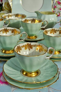 Grosvenor Vintage China Tea Set in pale green and gold... I would love a mix of pastel colors