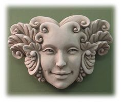 """Stylized face plaque like this are a great way to add personality to your garden or outdoor decorative space. Often referred to as """"Greenman"""" or """"Treeman"""" faces or plaques, they come in with a wide range of expressions - from comical to darkly foreboding. Come see the many moods I've added for your consideration soon!"""
