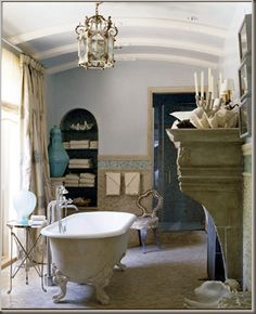 The Enchanted Home: Romantic rooms. I could enjoy this room, having a clawfoot tub and an old cottage home. Always a chandelier in the bathroom, jolts up the romance factor!