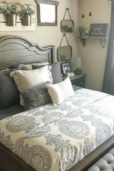 Most people think of clutter and rich colors when you talk about farmhouse, but this style complements minimalism extremely well while bringing a sense of relaxation. [Bedroom Ideas, Farmhouse Decor, Farmhouse Bedroom Ideas, Indoor Plants, Wooden Headboard, Minimalist Farmhouse Decor, Wall Planters Indoor, Throw Pillow Arrangement]