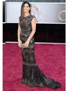 #Oscars2013 #BestDressed #2013_FlashBack : Sandra Bullock, peek-a-boo ... the Oscar golden girl showed some leg in Ellie Saab #Black #Lace #dress.