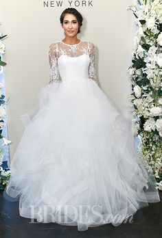 "Brides.com: . ""Esmeralda"" bateau neckline long-sleeve ball gown wedding dress with a Chantilly lace beaded bodice and a tulle skirt with horsehair, Sareh Nouri"