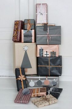 Never thought of using black and silver for holiday wrapping but I LOVE this! #lovelouetteboutique