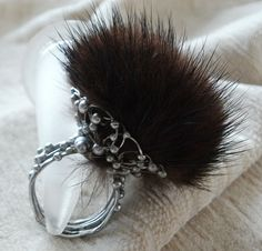 ring made ​​entirely by hand, with granulation and a pom pom of mink fur; Pimaripi Bijoux