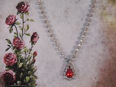 1980s RMN Red Tear Drop or Pear Shaped Crystal with Haloed Rhinestones and a Rhinestone Chain Silver Tone Pendant – Necklace by CarolsVintageJewelry on Etsy