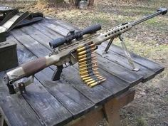 This is NOT a belt fed weapon, someone is an idiot for even showing it like this. I love the Barrett .50 calibre