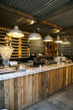 """love the lighting and reclaimed lumber with marble top for bar ideas Vintage ambiance in restaurant """"O Prego na Peixaria"""", Escola politécnica Lisboa. Rustic Coffee Shop, Coffee Shop Design, Wine Bar Design, Coffee Cafe, Rustic Cafe, Egg Coffee, Coffee Shop Bar, Rustic Wood, Coffee Shops"""