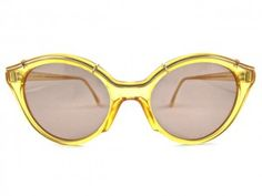 Christian Dior Sunglasses with golden frames.