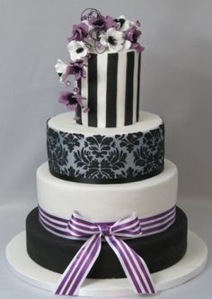 Black damask on a silver background, stripes and a spray of purple and white blossoms, sitting on a black stand  Art 'n Icing Wedding Cake, Wellington