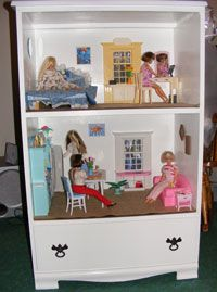 Turn an old dresser into a doll house, keeping the bottom drawer for the dolls when play time is over.