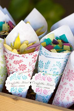 "After the ""I dos,"" have guests toss flower petals or tissue paper confetti in celebration. Evermine offers a colorful paper cone design that is a cinch to assemble (the scallop hang tags are an add-on).Download the free printable here ►"
