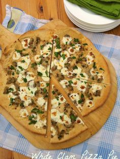 Love the bold flavors and simplicity of this White Clam Pizza Pie | Teaspoonofspice.com