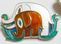 NORWAY DAVID ANDERSEN SILVER/ENAMEL MOM/BABY ELEPHANT PIN BROOCH SUPER UNUSUAL  in Jewelry & Watches, Vintage & Antique Jewelry, Vintage Ethnic/Regional/Tribal, Scandinavian | eBay ! Listed with start bid £158 Unsold ! Ended 30Nov2015 ! Seller ohthatspretty ! Enchanting Norwegian David Andersen vintage sterling & enamel mother & baby elephant pin brooch in vibrant red, blue, white and green enamel.  Super condition,  hard to find & fun to wear. Measures 2.1 inches wide by 1.5 inches high.