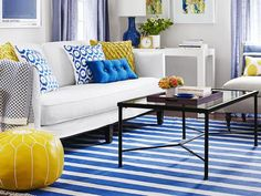 Beautiful blue livingroom with #yellow accents! #dream #home