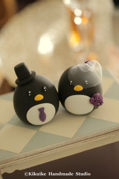 Hey, I found this really awesome Etsy listing at https://www.etsy.com/listing/195796058/penguins-wedding-cake-topper