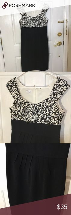 White and black floral dress! Stunning white and black floral dress! Zipper in the back, capped sleeves, slight slit at the bottom back hem, pleated at the collar bone and at the waist! Worn 2x. London Times Dresses
