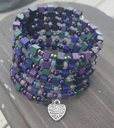 Check out this item in my Etsy shop https://www.etsy.com/listing/552824982/memory-wire-bracelet-with-beautiful-iris