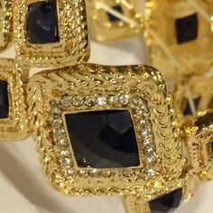 Gold and Black Bracelet HOST PICKGold tone stretch bracelet with clear crystals and black stones all the way around.  The bracelet pieces are all diamond shapes.  It comes with it's  own velvet storage pouch!  NWT Jewelry Bracelets
