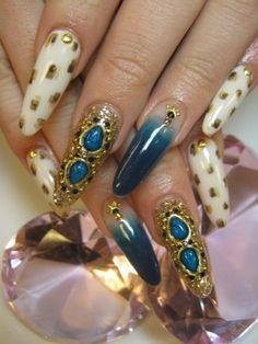 Turquoise Stiletto Nails